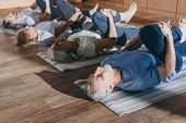 Group Of Senior People Stretching In Yoga Mats In Studio poster