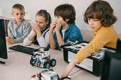 Little Kids Constructing Robots At Stem Education Class poster