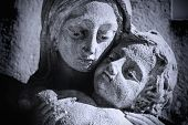 Close Up Of Ancient Statue Virgin Mary Holding A Baby Jesus On A Cross As Symbol Of Empathy And Suff poster