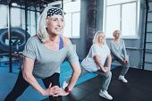Say No To Arthritis Pain. Selective Focus On A Joyful Woman Smiling While Lunging With A Group Of El poster