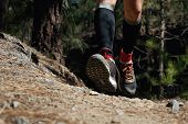 Trail Running Man On Mountain Path Exercising,freeze Action Closeup Of Running Shoes In Action poster