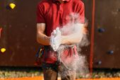 Close Up Of Climber Man Coating Hands In Powder Chalk Magnesium And Preparing To Climb Outdoor Train poster