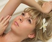 Beautiful woman with flowers in her hair lying