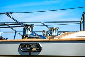 Motor Sailing Yacht Boat Cabing And Steering Wheel On Clear Blue Sky In Background. poster
