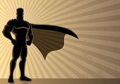 stock photo of mantle  - Superhero over a grunge background with copy space. 