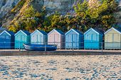 Idyllic Seaside Beach Huts In Bournemouth, Uk poster