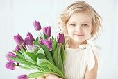 Girl Holding Tulips In Hands poster