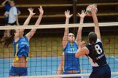 KAPOSVAR, HUNGARY - APRIL 24: Gabriella Kondor (13) blocks the ball at the Hungarian NB I. League woman volleyball game Kaposvar (blue) vs Ujbuda (black), April 24, 2011 in Kaposvar, Hungary.