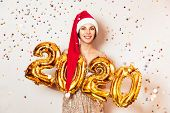 New Year 2020 Gold Number Balloons. Beautiful Woman With Balloons Celebrating New Years Eve Party. I poster