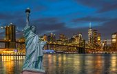 The Statue Of Liberty Over The Scene Of New York Cityscape With Brooklyn Bridge Beside The East Rive poster