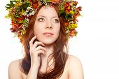 red haired woman with flower wreath on head