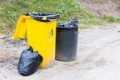 Yellow Trash On The Street.