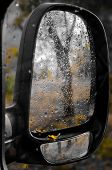 Close-up Of Wet Car Mirror. Autumn Alley Is Reflected In Side Mirror Wet From Rain. Autumn Concept.  poster