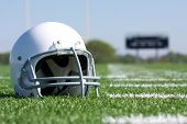 American Football Helmet on the Field with room for copy