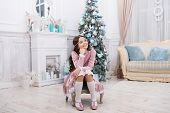 Making Wish. Waiting For Santa Claus. Adorable Girl Making Wish Near Christmas Tree Decorated Interi poster