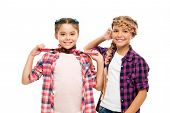 Haircare Begins With Natural Products. Happy Children Hold Long Hair Braids. Haircare And Hairstylin poster