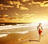 Healthy woman running on the beach, girl doing sport outdoor, happy female exercising, freedom, vaca
