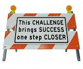 A construction barrier with the words This Challenge Brings You One Step Closer to Success to motiva