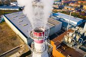 Aerial view to industrial area with chemical plant. Smoking chimney from factory. Air pollution and  poster