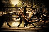 Amsterdam, Holland, Netherlands. Romantic canal bridge, retro bike. Old town