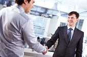 Image of two business men handshaking and concluding the deal