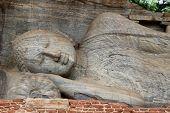 Close Up Of The Reclining Buddha Statue At Gal Vihara, Polonnaruwa, Sri Lanka.  The Buddha Statue Is poster