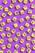 Dyslexia Word Yellow On Pink Purple With Scattered Letters Cubes Around, Reading Difficulty And Diso poster