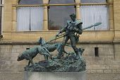 Statue Of Hunter With Dogs