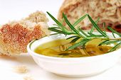 Bowl Of Olive Oil With Rosemary And Bread