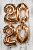 Happy New Year 2020 Celebration. Bright Gold Balloons Figures, New Year Balloons With Glitter Stars  poster