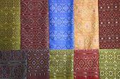 pieces of colorful praewa silk fabric cloth using as background