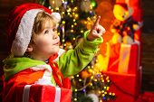 Boy Cute Child Cheerful Mood Play Near Christmas Tree. Gifts For Winter Holidays Near Fire Place. Ch poster