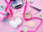Lipstick, Eye Shadow, Cream To Create Makeup On A Pink Background With Marshmallows, Next To A Satin poster