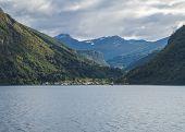 Beautiful Norwegian Fjord. View Across Storfjorden, Towards Village Eidsdal. Summer, Blue Sky. Norwa poster