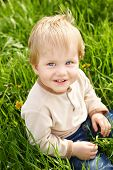 Happy Little Boy In Grass