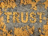 stock photo of morals  - Losing trust and deteriorating integrity as a business concept represented by old fading yellow cracked paint on a rough cement wall showing the business metaphor of lost morality and illegal financial bank and stocks transactions - JPG