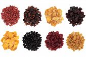 Goji berry, sultana, pineapple, cranberry, mango, elderberry, cherry and golden raisin dried fruit over white background.