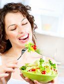 Dieting concept. Healthy Food. Diet. Beautiful Young Woman Eating Vegetable Salad. Vegetarian Food