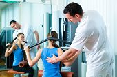 Patient at the physiotherapy making physical exercises with her therapist