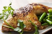 roast chicken leg with cooked with rosemary and served with green beans