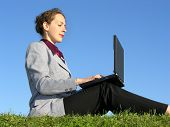 Businesswoman Sit With Notebook On Blue Sky 2 poster