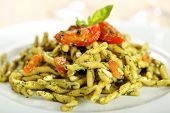 Italian pasta with pesto and tomatoes