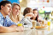 Image of teenage couple spending time in cafe