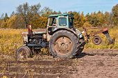 Old Tractor At The Field In Sunny Day