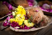 foto of pooja  - Flower and coconut offerings for Hindu religious ceremony or holy festival - JPG