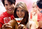 image of night-club  - couple in a bar having a drink and smiling - JPG