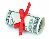 Dollars with gift bow isolated on white