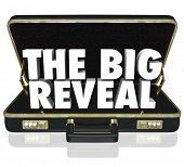 A black leather briefcase with words The Big Reveal inside as a surprise or shocking discovery being