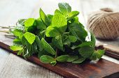 picture of peppermint  - Green mint leaves with lime on wooden background - JPG