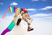 stock photo of kites  - happy father and little girl with colorful kite - JPG